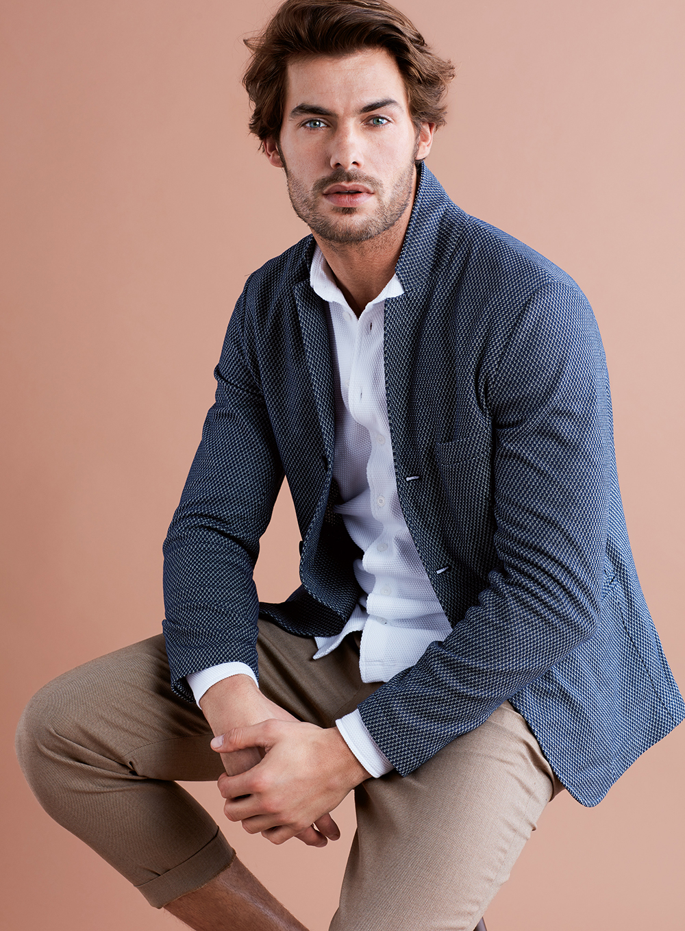 A double-breasted blazer and the jackets are made in three-dimensional  textured fabrics with scuba taking the place of the more classic  lightweight jacket. 6f96519d2dd