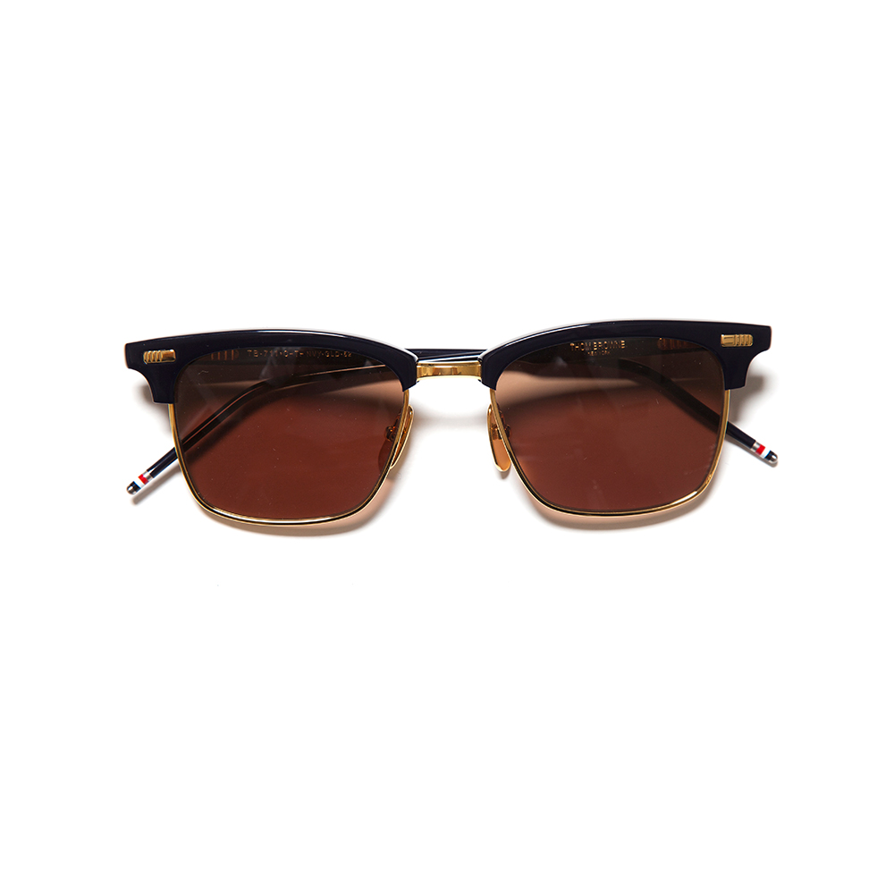 Sunglasses by Thom Browne, available at Tartaras.